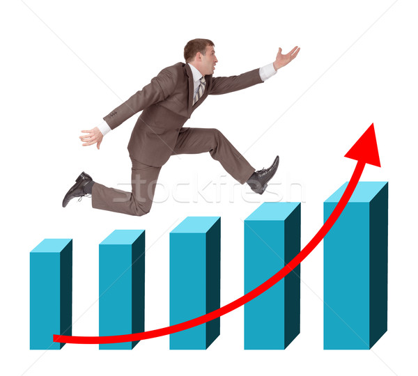 Businessman running with hand forward on graph Stock photo © cherezoff