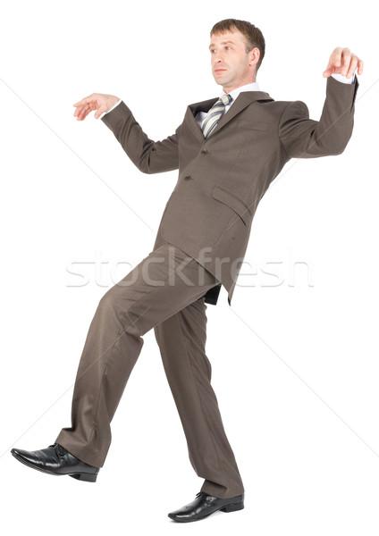 бизнесмен ходьбе осторожно баланса изолированный белый Сток-фото © cherezoff