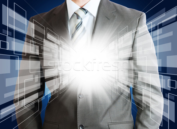 Businessman with glowing abstract background Stock photo © cherezoff