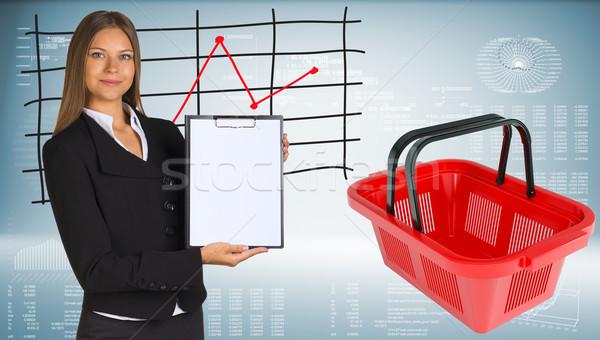 üzletasszony bevásárlókosár grafikonok tart papír grafikon Stock fotó © cherezoff