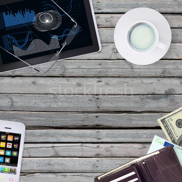 Yalan tablet cüzdan iş Stok fotoğraf © cherezoff