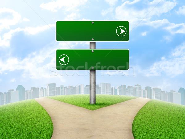 дорожный знак город зеленая трава вилка способом Сток-фото © cherezoff