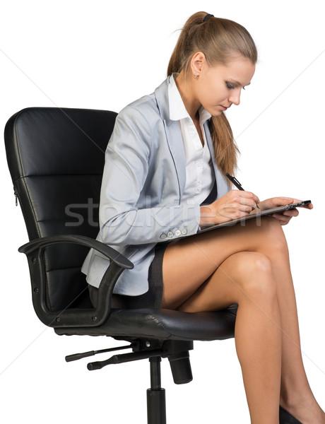 Işkadını oturma ofis koltuğu yazı yalıtılmış Stok fotoğraf © cherezoff