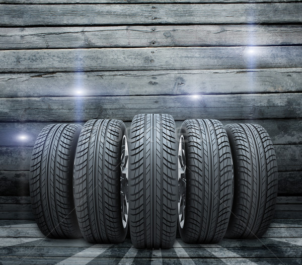 Wedge of new car wheels. Background is wooden boards Stock photo © cherezoff