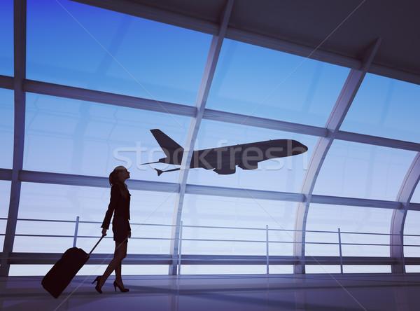 Businesslady holding luggage Stock photo © cherezoff