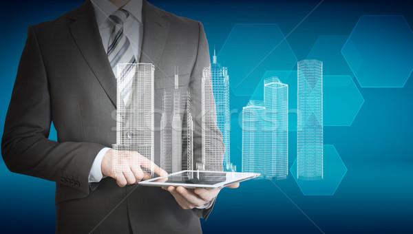 Сток-фото: бизнесмен · таблетка · 3D · модель · город · аннотация