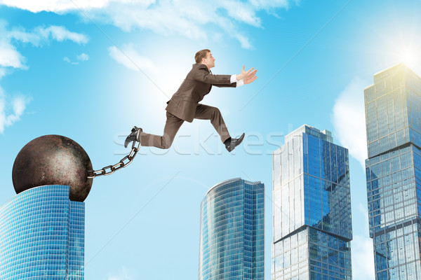 Young man jumping over gap Stock photo © cherezoff