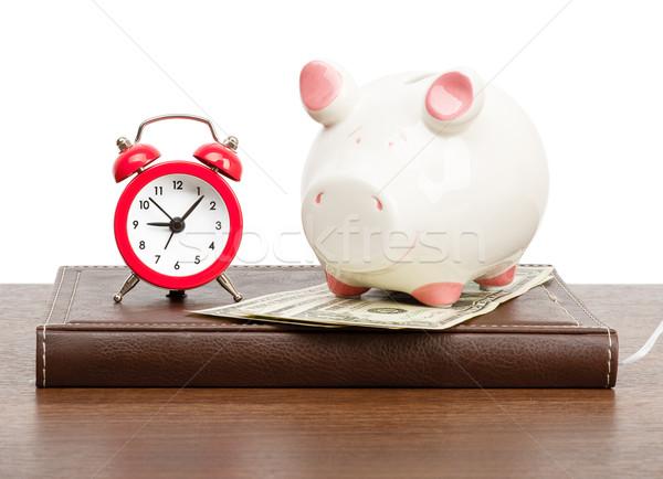 Alarm clock with piggy bank Stock photo © cherezoff