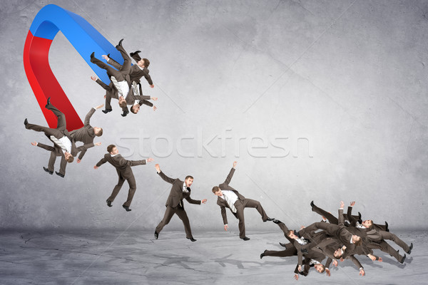 Businessmen attracted within magnet Stock photo © cherezoff