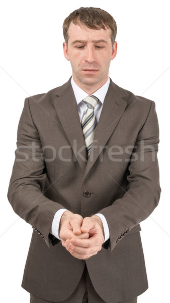 Unhappy businessman looking at his hands Stock photo © cherezoff