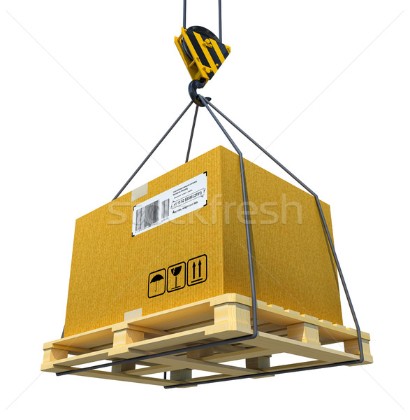 Pallet with cardboard lifted by crane Stock photo © cherezoff