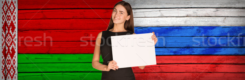Businesswoman holding paper sheet Stock photo © cherezoff
