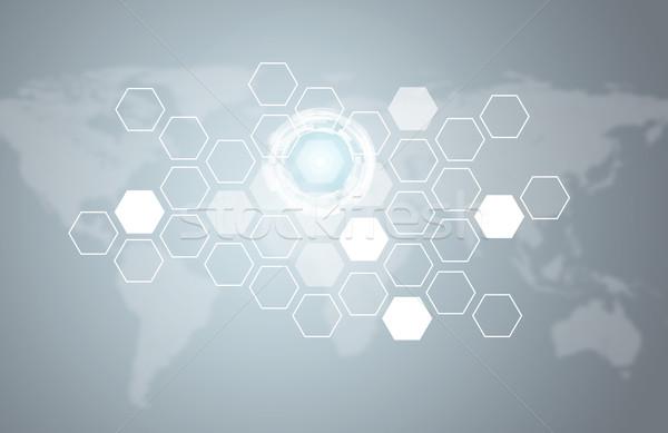 Stock photo: Transparent hexagons, glow circles and world map