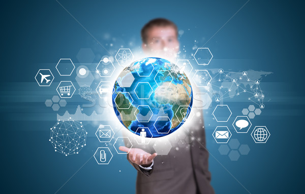 Stock photo: Businessman hold Earth with graphs, hexagons and network