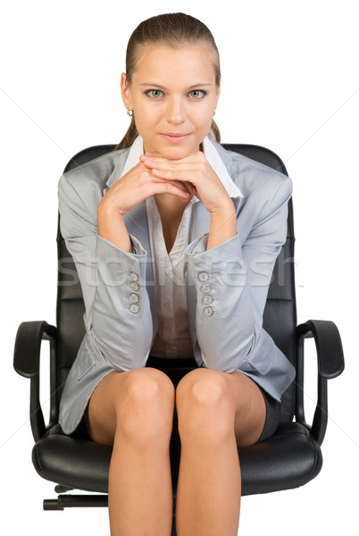 Businesswoman on office chair, with head reclined upon her hands Stock photo © cherezoff