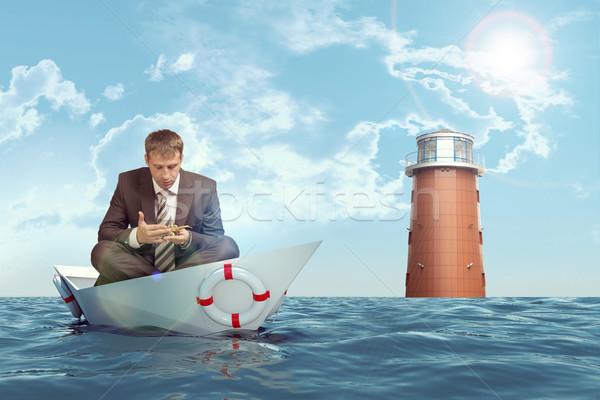 ビジネスマン 座って 蓮 位置 紙 ボート ストックフォト © cherezoff