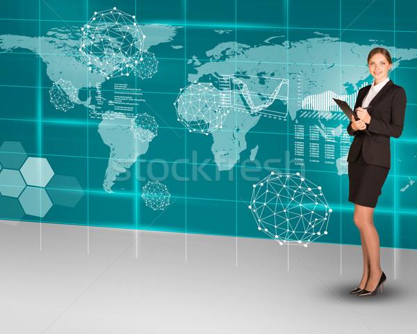 Businesswoman with folder and world map Stock photo © cherezoff