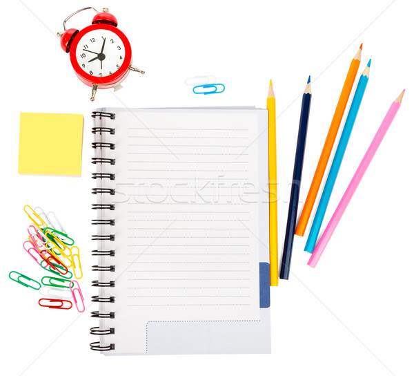 Open notebook with stationery and alarm clock Stock photo © cherezoff