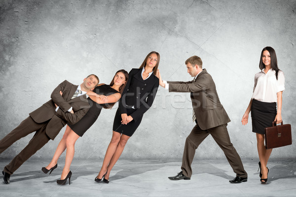 Businessman supporting business people Stock photo © cherezoff