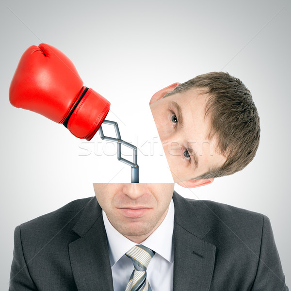 Boxing glove beating from businessmans head Stock photo © cherezoff