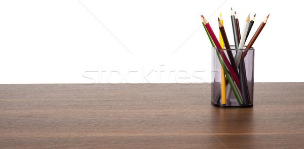 Colorato pastelli mug tavolo in legno isolato bianco Foto d'archivio © cherezoff