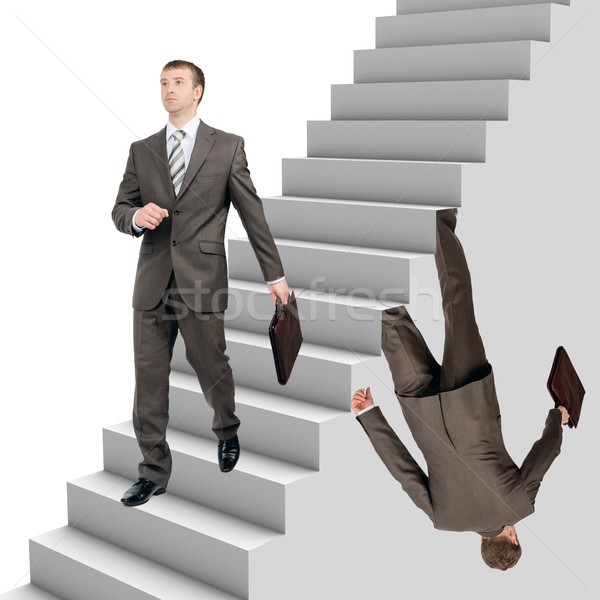 Businessman falling out of stairs  Stock photo © cherezoff