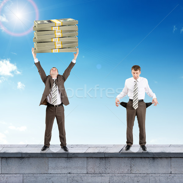 Sad and happy businesspeople with money  Stock photo © cherezoff