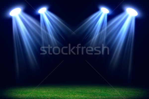 Grass field lit with bright spotlights Stock photo © cherezoff