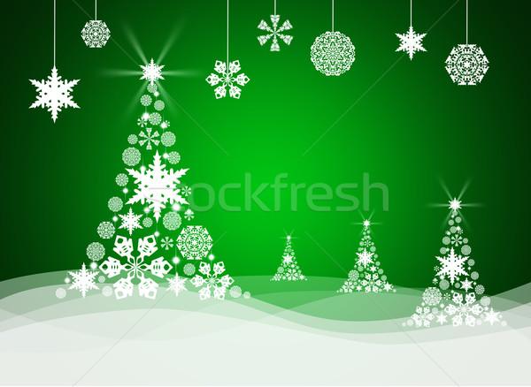 Christmas tree from white snowflakes Stock photo © cherezoff