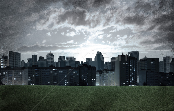 вечер город зданий зеленая трава области Гранж Сток-фото © cherezoff