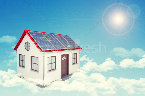 White house with red roof, solar panels in cloud. Background sun shines brightly Stock photo © cherezoff