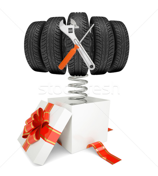 Gift box and car tires with tools on spring Stock photo © cherezoff