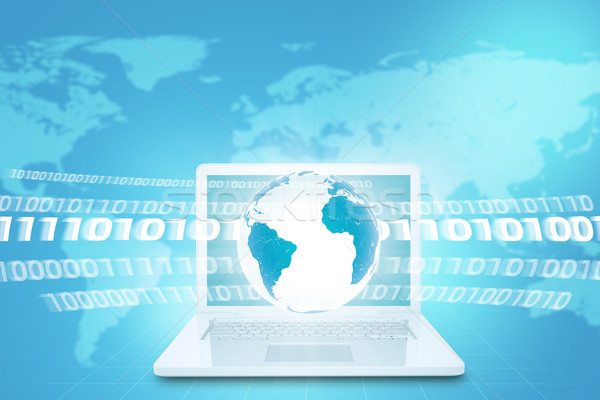 Earth above white laptop with world map Stock photo © cherezoff