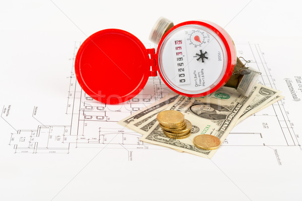 Water meter with cash on draft Stock photo © cherezoff