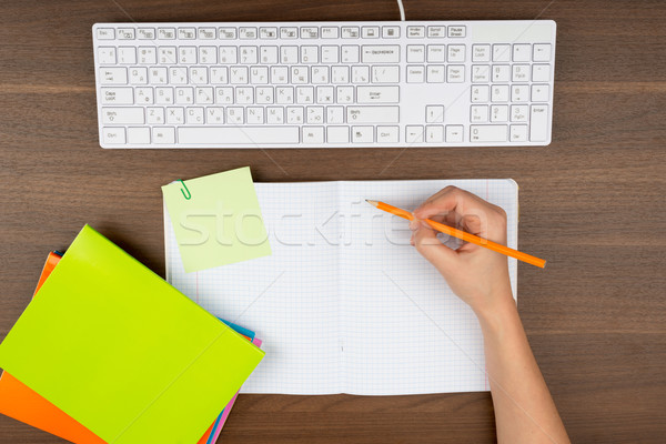 Humans hand writing in copy book Stock photo © cherezoff