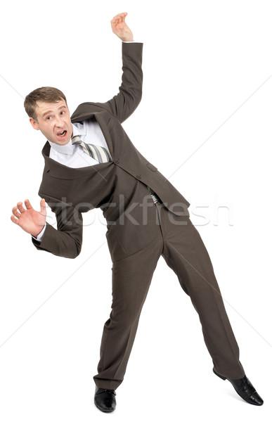 Ijedt üzletember zuhan pozició izolált fehér Stock fotó © cherezoff