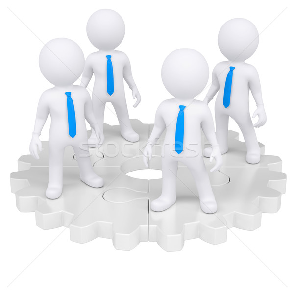 Four people standing on the gear Stock photo © cherezoff