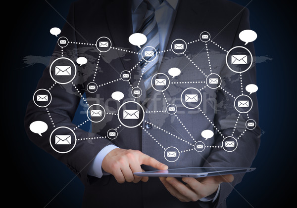 Man in suit, tablet pc and contacts Stock photo © cherezoff