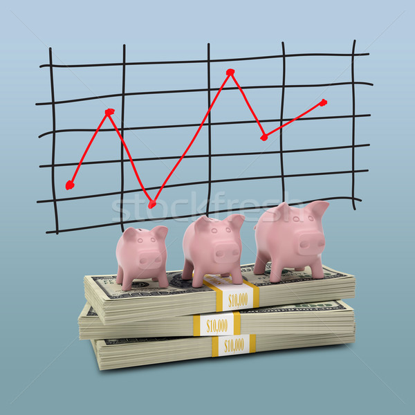Piggy bank stand on pack of dollars Stock photo © cherezoff
