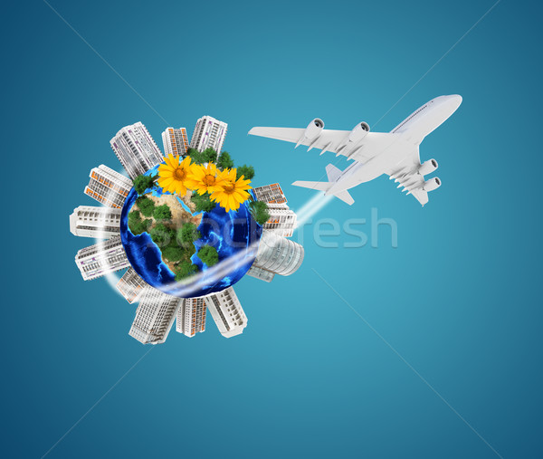 Earth model with city and flowers around  Stock photo © cherezoff