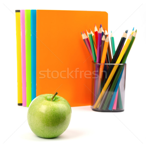 Copybooks with fresh apple and crayons Stock photo © cherezoff