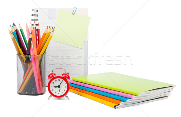 Crayons with notebooks and alarm clock Stock photo © cherezoff