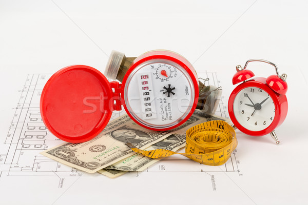 Red water meter with tape-measure and alarm clock Stock photo © cherezoff