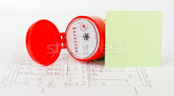 Water meter with sticker on draft Stock photo © cherezoff