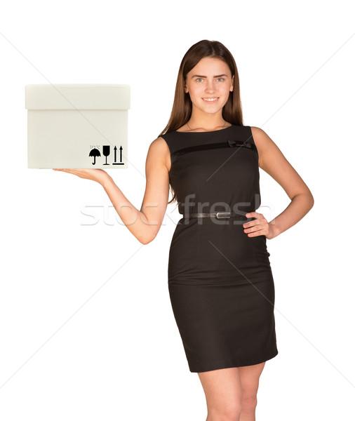 Businesslady holding white box Stock photo © cherezoff