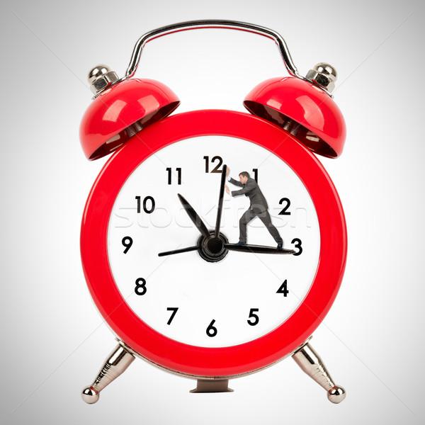 Businessman pushing clock hand Stock photo © cherezoff
