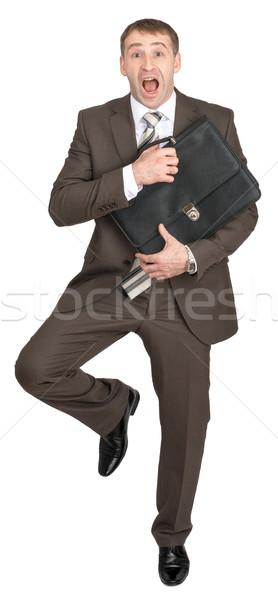 страшно бизнесмен портфель глядя камеры изолированный Сток-фото © cherezoff