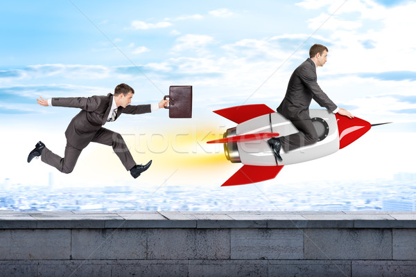 Running businessman following man flying on rocket Stock photo © cherezoff
