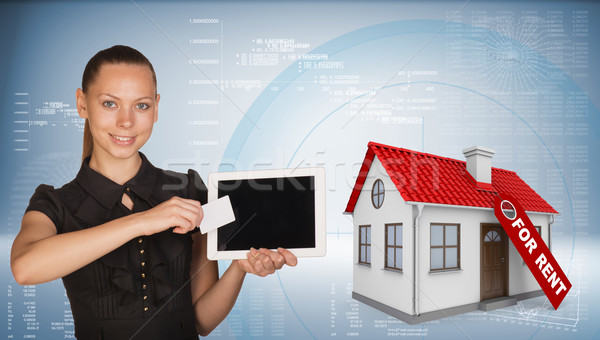 Gyönyörű üzletasszony tart táblagép vmi mellett ház Stock fotó © cherezoff