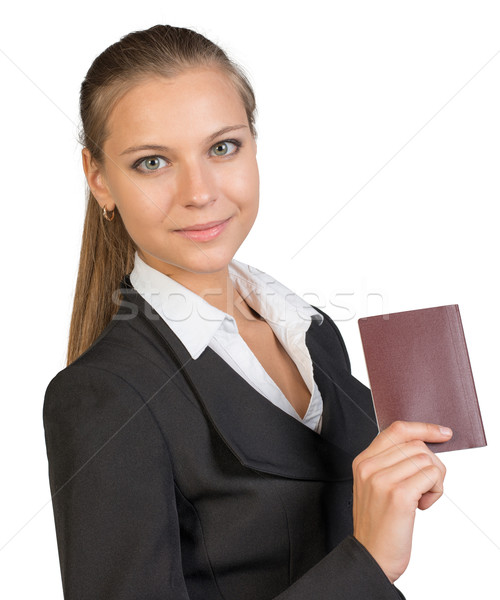 Businesswoman showing passport with blank cover Stock photo © cherezoff
